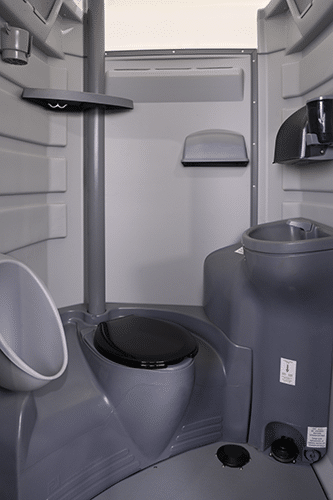 Interior with flushable toilet and sink